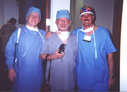 Live Surgery – Workshop, Orlando, USA, February 2001. From the left side: Dr Patrick Frechet (France), Dr Marcelo Gandelman (Brazil), Dr Jerzy Kolasiński.